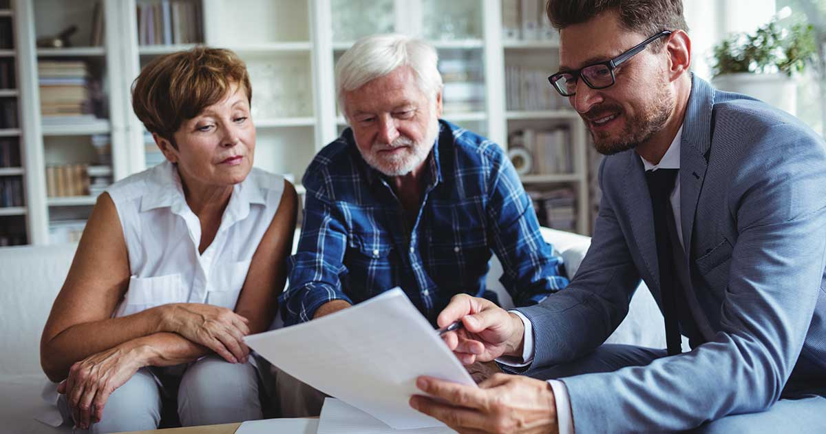 Two People Discuss Retirement with Financial Advisor