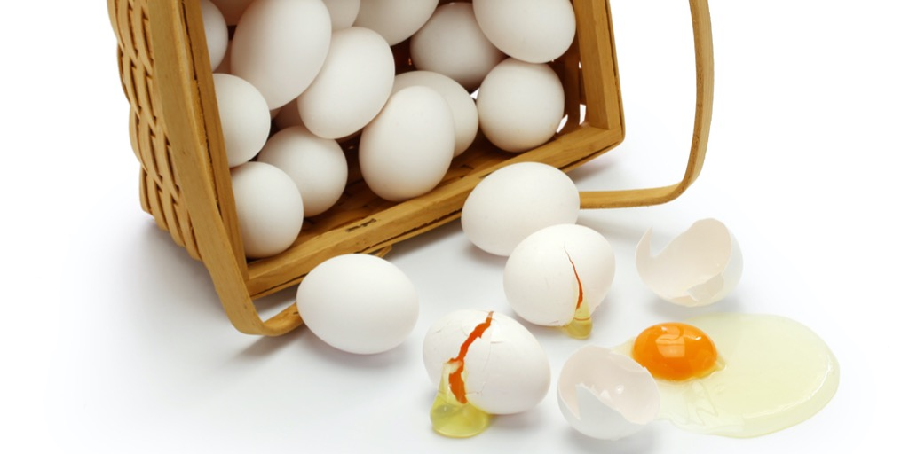 Eggs spilling out of a basket.