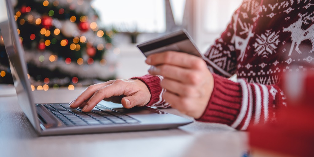 Woman Shopping Online wearing a Holiday Sweater